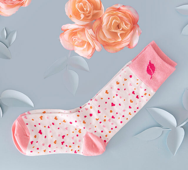white socks with pink and orange hearts
